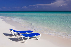 Caribbean beach with sunbed in Cuba. Caribbean beach in Cuba, Cayo Guillermo, with sunbeds in the white sand royalty free stock photo