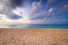 Caribbean beach at sunrise Royalty Free Stock Photos