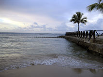 Caribbean beach at sunset. View on the border walk Royalty Free Stock Photography