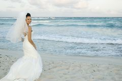 Caribbean Beach Wedding - Brid. Bride on beach striking a pose royalty free stock photos