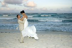 Caribbean Beach Wedding - Cele. Bride and groom celebrating on the beach stock photo