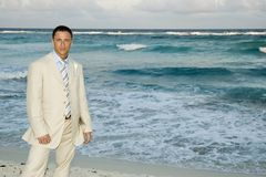 Caribbean Beach Wedding - Groom Posing. Groom on beach striking a GQ pose stock photo