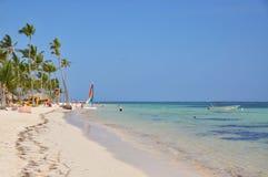 Caribbean beach and white motor boat stock image