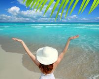 Caribbean beach woman rear view hat open arms Stock Image