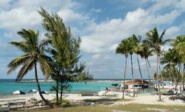 Caribbean Beachlife. Caribbean beach with palms and restaurant Stock Images