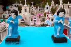 Caribbean cemetery catholic angel saints figures. Caribbean children cemetery catholic angel saints figures colorful Mexico Royalty Free Stock Photos
