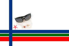 Caribbean Christmas Border with Sunglasses. A tropical Christmas border with a red star fish in the corner,a pair of sunglasses with a reflection of a Caibbean Royalty Free Stock Images