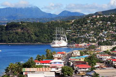 Caribbean City. Cruise ship coming into a caribbean city Roseau on the island of Dominica stock photos