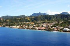 Caribbean City. Cruise ship coming into a caribbean city Roseau on the island of Dominica Stock Photos