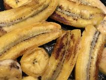 Caribbean cuisine Vegetarian dish yellow fried bananas - plane trees in butter or vegetable oil royalty free stock photos