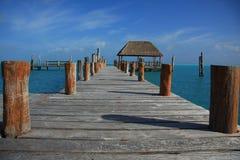 Caribbean dock. Beautiful wooden dock in Caribbean tropical waters Stock Photo