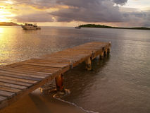 Caribbean dock at sunset. A view of a dock on a resort beach on St. Croix in the US Virgin Islands in the Caribbean Sea at sunset Stock Photos