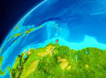 Caribbean on Earth from space. Orbit view of Caribbean highlighted in red on planet Earth. 3D illustration. Elements of this image furnished by NASA Royalty Free Stock Images