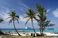Caribbean Feeling. Palm beach with a cruise ship in the background Stock Photo