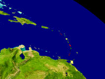 Caribbean with flag on Earth. Map of Caribbean with embedded flag on planet surface. 3D illustration. Elements of this image furnished by NASA Royalty Free Stock Photos