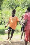 Caribbean football. Caribbean men playing football together stock photos