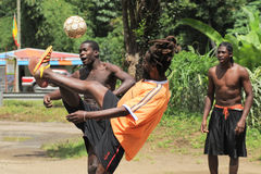 Caribbean football. Caribbean men playing football together royalty free stock images