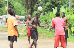 Caribbean football. Caribbean men playing football together stock photography