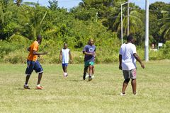Caribbean football. Team in Barbados playing football in Speightstown royalty free stock images