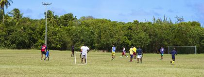 Caribbean football. Team in Barbados playing football in Speightstown stock photos