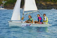 Caribbean fun - young girls in a sailing boat Royalty Free Stock Photos