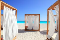 Caribbean gazebo beds in tropical beach sand Royalty Free Stock Photos