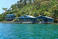 Caribbean home and boat house over the water Stock Images