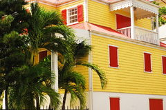 Caribbean House. Colorful yellow and red home on the island of St. Croix, US Virgin Islands, Danish architecture Royalty Free Stock Images