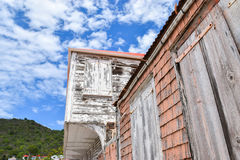 Caribbean house. Detail of old wooden building in town of St Barts, the Caribbean. Blue sky and clouds in background Royalty Free Stock Photography