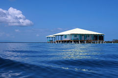 Caribbean house on stilts over the sea Royalty Free Stock Image