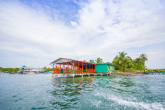 CARIBBEAN HOUSE WATER. BOCAS, PANAMA - APRIL 15, 2015: Houses on the shore of the island of Colon in Bocas del Toro which is the capital of the province of the Stock Photos