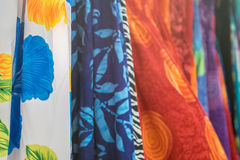 Caribbean Island fabric in marketplace. Caribbean island themed fabric in bright colors. Designs include shells, flowers and swirls Stock Image