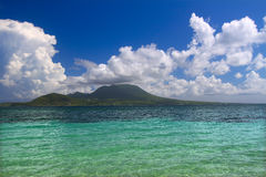 Caribbean island of Nevis. View of the Caribbean island Nevis from Saint Kitts Royalty Free Stock Photography