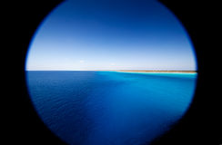 Caribbean Island through peephole. In Cruise Ship Royalty Free Stock Images