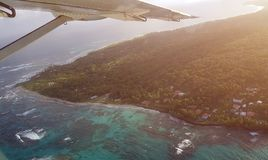 Caribbean island from window of aeroplane. On bright sunny day royalty free stock photo