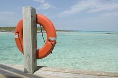 Caribbean Life Saver. An orange life saver hangs from the dock at a remote Caribbean location stock photography