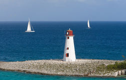 Caribbean Lighthouse With Sail Stock Photos