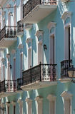 Caribbean living. Wrought iron railings cast shadows across historic buildings in the Caribbean Royalty Free Stock Photography