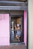 Caribbean mid age woman standing by the door, Caracas stock photography