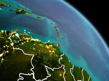 Caribbean in morning from orbit. Early morning view of Caribbean highlighted in red on planet Earth with visible border lines and city lights. 3D illustration Stock Photos