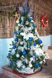 Caribbean new year tree with balls and toys. Closeup Stock Photo