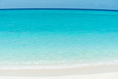 Caribbean ocean and beach. Caribbean ocean with turquoise blue water and white beach, Maldives island Stock Image