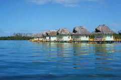 Caribbean overwater bungalows with thatched roof. Caribbean over water bungalows with thatched roof, Bocas del Toro, Central America, Panama stock photos