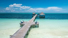 Caribbean paradise found in Cuba: walking dock and bench where you can sit  in the middle of the sea. Royalty Free Stock Images
