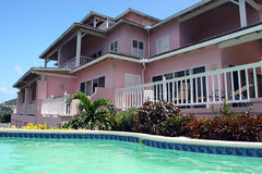 Caribbean Pink hotel. Near beach with Pool view Stock Images