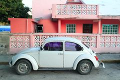 Caribbean pink house tropical retro car facade Royalty Free Stock Photos