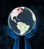 Caribbean on political globe in hands vector illustration