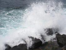Caribbean Rage. Caribbean waters splash against rock beach in Puerto Rico Royalty Free Stock Photo