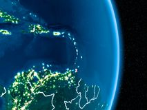 Caribbean in red at night. Caribbean from orbit of planet Earth at night with visible borderlines and city lights. 3D illustration. Elements of this image Royalty Free Stock Photography