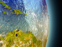 Caribbean in red from space. Model of Caribbean from Earth's orbit in space. 3D illustration with highly detailed realistic planet surface and clouds in the Royalty Free Stock Photos